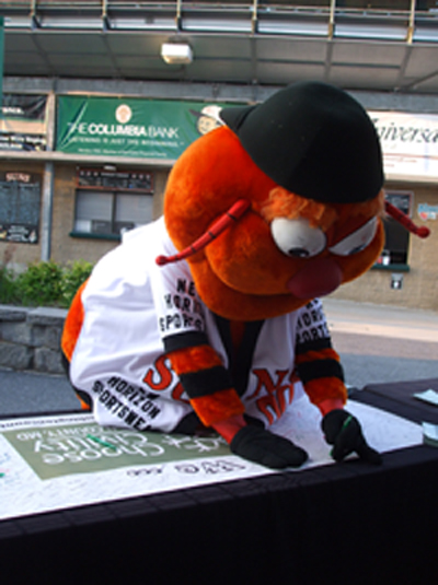 Suns mascot, Wollie signs our Choose Civility Banner
