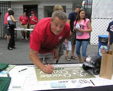 Interim General Manager Bob Bruchey signs the Choose Civility Banner